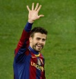 Barcelona defender Gerard Pique signals to the crowd after Barcelona's fifth goal