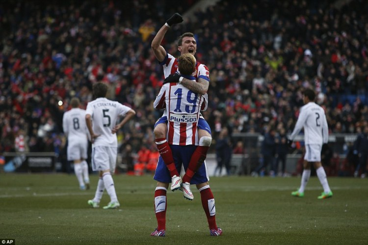 Mario Mandzukic celebrates Atletico's fourth goal with Fernando Torres in the Madrid Derby