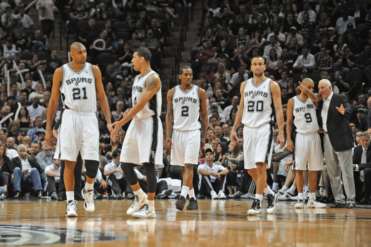 SAN ANTONIO, TX- MAY 15: Gregg Popovich, Head Coach of the San Antonio Spurs gives direction to Tony Parker #9 during a break in the action against the Los Angeles Clippers in Game One of the Western Conference Semifinals during the 2012 NBA Playoffs on May 15, 2012 at the AT&T Center in San Antonio, Texas.  NOTE TO USER: User expressly acknowledges and agrees that, by downloading and or using this photograph, User is consenting to the terms and conditions of the Getty Images License Agreement. Mandatory Copyright Notice: Copyright 2012 NBAE  (Photo by Noah Graham/NBAE via Getty Images)
